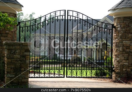 Brick Mansion stock photo, Brick mansion behind iron gate by Darryl Brooks