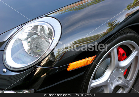 Sports Car stock photo, Close up of headlight and fender of black German sports car by Darryl Brooks