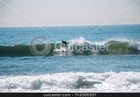Riding the waves stock photo, A surfer riding the waves on the ocean by Rob Wright