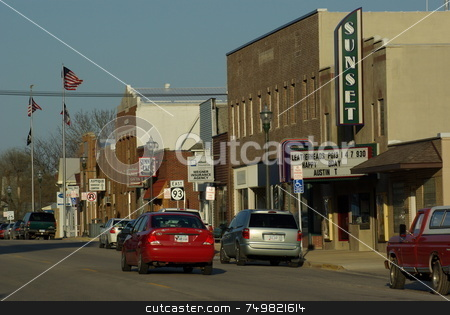 Rural Main Street USA stock photo, Main street (1st Street) in the busy rural community of Sumner, Iowa  proudly hosts a single screen movie theater.  The theater was restored with a fund-raiser and volunteer workers after being closed for many years.  Admission to the weekly first-run attraction is 99 cents. by Dennis Thomsen