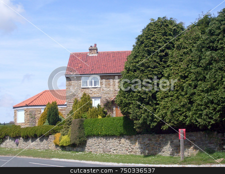 Picturesque house in countryside stock photo, Picturesque house in countryside, north yorkshire moors national park, England. by Martin Crowdy