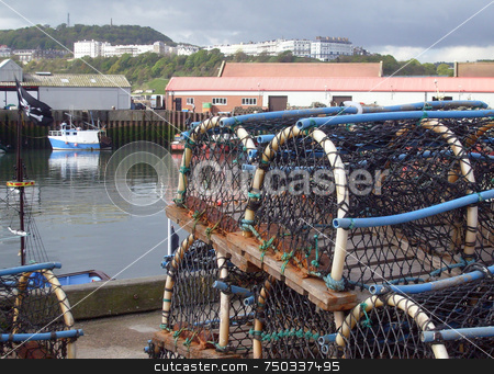 Lobster pots in harbor stock photo, Lobster pots on quayside in harbor scene, Scarborough, England. by Martin Crowdy