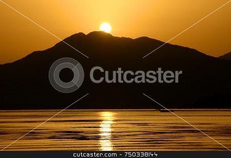 Sunrise in Marmaris stock photo, Reflecting sunrise in the gulf of Marmaris by Kobby Dagan