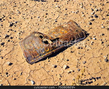 Colorado 1959 stock photo, An old Colorado license plate rusting away in a desert in Utah. by Mike Norton