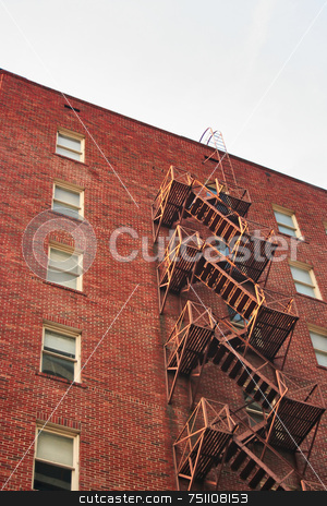 Fire Escape stock photo, A fire escape going down the side of a brick building by Kevin Tietz