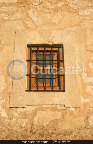 Old Window stock photo, An old window with wrought iron bars cased into stone by Kevin Tietz