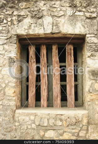 Old Window stock photo, An old window with wood bars cased into stone by Kevin Tietz