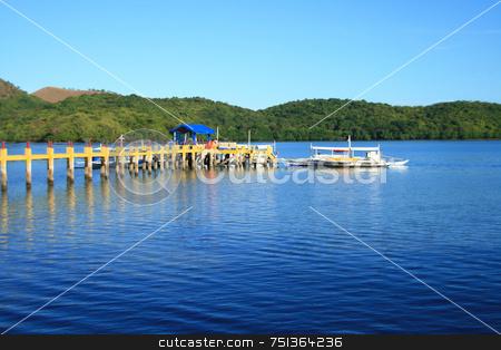 Pier 3 stock photo, A pier from a resort leading to a boat by Jonas Marcos San Luis
