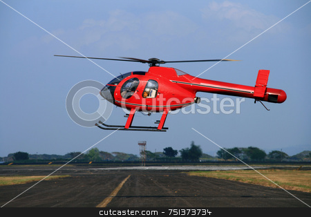 Red helipcopter 1 stock photo, Rotorless red helicopter hovering over an airfield by Jonas Marcos San Luis