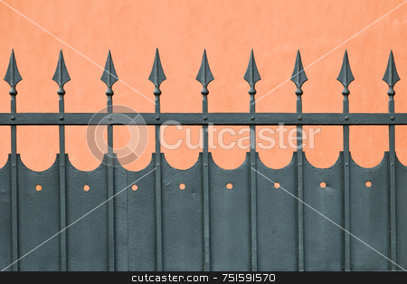 Iron wrought Fence stock photo, Wrought iron fence with arrow head protecting house by Massimiliano Leban