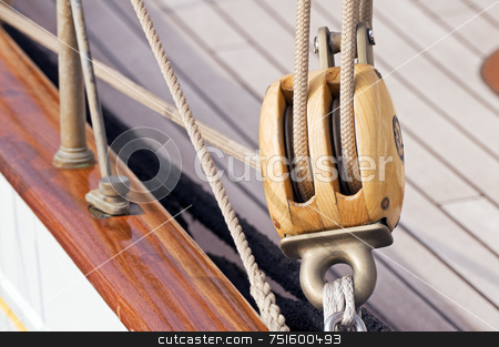 Wooden block stock photo, Detail of a wooden sailboat: pulley with ropes by Massimiliano Leban