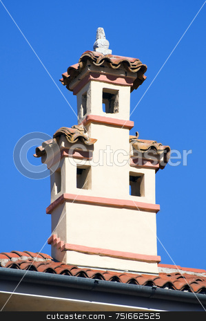 Chimney stock photo, Close-up of a chimney against a blue sky by Massimiliano Leban