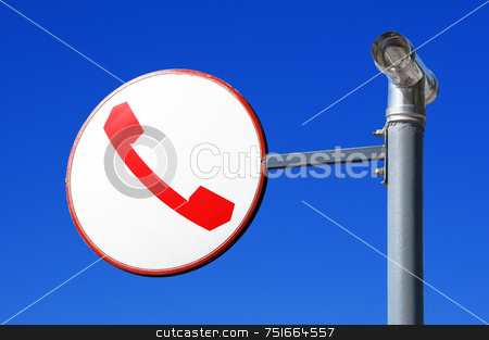 Telephone sign stock photo, Round sign with telephone against blue sky by Massimiliano Leban