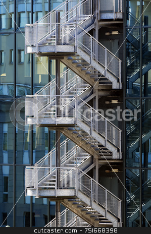 Fire escape stair stock photo, Detail of metallic fair escape stair outside of an office building by Massimiliano Leban