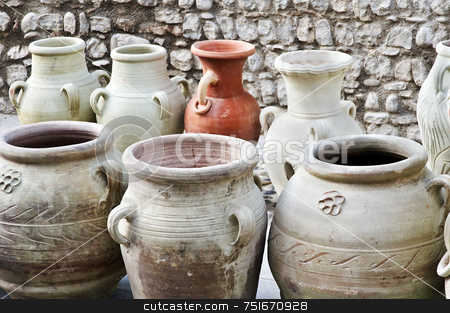 Vases and amphoras stock photo, Different kind of terracotta containers displayed in a street market by Massimiliano Leban