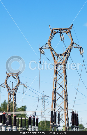 Pylons stock photo, High voltage pylons against blue sky by Massimiliano Leban