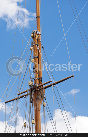 Mast stock photo, Wooden mast of a sailboat against the sky by Massimiliano Leban
