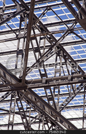 Steel Structure stock photo, Detail of steel framework of a roof against a blue sky by Massimiliano Leban