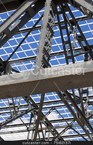 Steel framework stock photo, Detail of steel structure of a roof against a blue sky by Massimiliano Leban