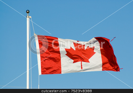 Canadian Flag stock photo, A canadian flag shot against a blue cloudless sky by Richard Nelson