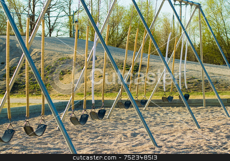 Playground Swings stock photo, A set of empty swings in a background by Richard Nelson