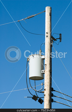 Power Line Pole stock photo, Close-up view of the top of a power line pole with transformer by Richard Nelson