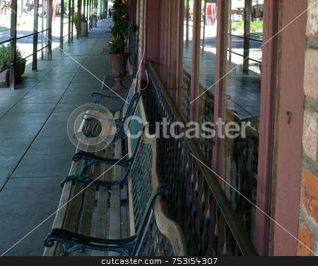 Small Town Covered Walkway stock photo, A covered walkway in front of local shops in a small town. by Lynn Bendickson