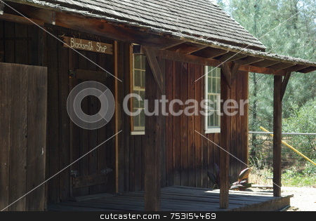 Old West Blacksmith Shop stock photo, An Old West Blacksmith building viewed from the outside. by Lynn Bendickson