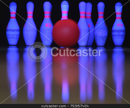 Bowling a strike stock photo, A bowling ball just about to hit the pins. by Lucy Clark