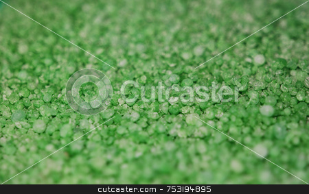 Emerald Granules Background stock photo, A close up photograph of green granules by Philippa Willitts