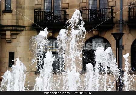 Jumping Water stock photo, A photograph of fountains in the Peace Gardens in Sheffield, England, with the Town Hall in the background. by Philippa Willitts