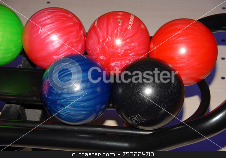 Bowling balls stock photo, Row of bowling balls, waiting their turn. by Joanna Szycik