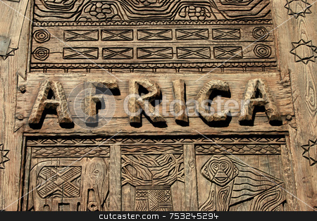 Africa Sign stock photo, An Africa sign on wood with carvings. by Lucy Clark