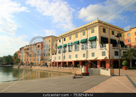 Hotel stock photo, A hotel with a lake and blue sky. by Lucy Clark