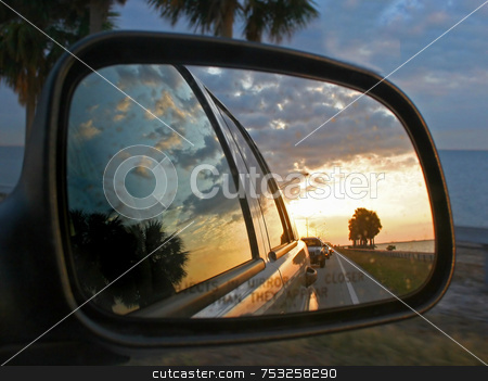 Car Mirror Reflection stock photo, The Reflections of cars and a sunset by Lucy Clark