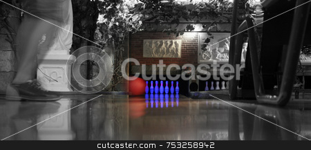 Bowling stock photo, A bowling lane with ball pins and ball return. by Lucy Clark