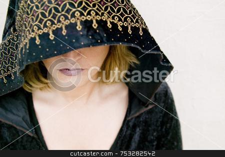 Sorcerress stock photo, New Age priestess Under a Hood by Scott Griessel