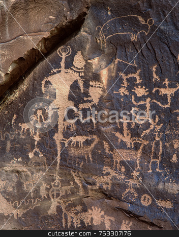 Petroglyphs on Newspaper Rock stock photo, Petroglyphs on Newspaper Rock in Newspaper Rock State Park, Utah. by Mike Norton