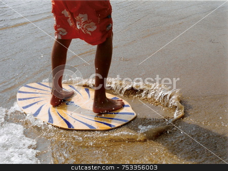 The Skim Board stock photo, A friend on his skimboard in the UK. by Lucy Clark