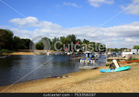 Christchurch River stock photo, Christchurch river at a regatta with boats and sand. by Lucy Clark