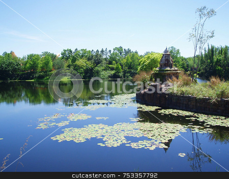 Lake And Trees stock photo, A lake / river with lily pads and trees in the background by Lucy Clark