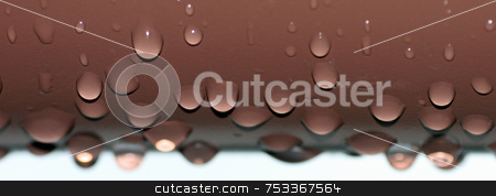 Water Drops stock photo, Water Droplets coming off of a balcony by Lucy Clark