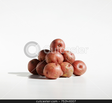 Potato Pile stock photo, Pile of organic red potatos against a pure white background. by Scott Griessel