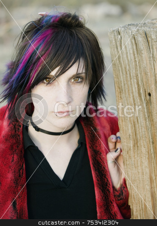 Young Girl  stock photo, Young Girl with A Magenta Streak in her Hair by Scott Griessel