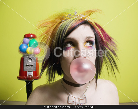 Punk Girl in front of a Green Wall Blowing a Bubble stock photo, Punk Girl in front of a Green Wall Blowing a Bubble by Scott Griessel