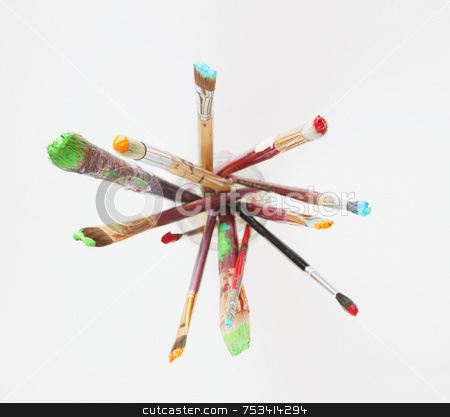 Paint brushes in a Glass Jar stock photo, Paintbrushes in a glass jar against a white background, shot from above. by Scott Griessel