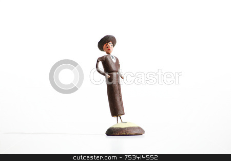 Mexican Clay Toy Figurine stock photo, Whimsical mexican clay toy cowboy on a white background. by Scott Griessel