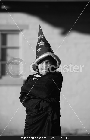 Boy Wizard stock photo, Youn boy with a wizard hat pursing his lips by Scott Griessel