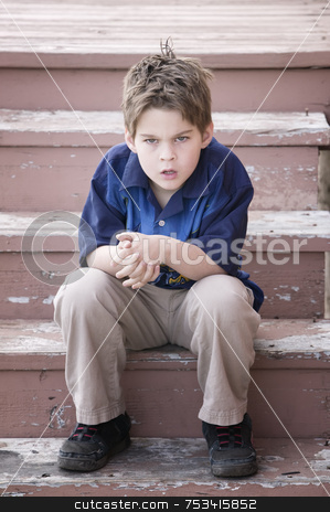 Grumpy Boy stock photo, Grumpy Young Boy Sitting on Peeling Stairs by Scott Griessel