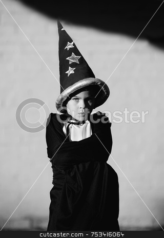 Boy Wizard stock photo, Youn boy with a wizard and his arms crossed by Scott Griessel